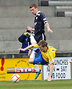 ACCIES' ANDY RYAN IS UPENDED BY ROVERS IAIN DAVIDSON