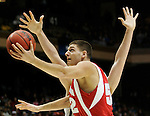 Wisconsin forward Keaton Nankivil, front, goes up for a shot against Xavier in the first half of a second-round men's NCAA college basketball tournament game in Boise, Idaho, Sunday, March 22, 2009. (AP Photo/Paul Sakuma)