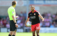 Swindon Town's Keshi Anderson makes a point to Referee Michael Salisbury<br /> <br /> Photographer Chris Vaughan/CameraSport<br /> <br /> The EFL Sky Bet League Two - Lincoln City v Swindon Town - Saturday 11th August 2018 - Sincil Bank - Lincoln<br /> <br /> World Copyright &copy; 2018 CameraSport. All rights reserved. 43 Linden Ave. Countesthorpe. Leicester. England. LE8 5PG - Tel: +44 (0) 116 277 4147 - admin@camerasport.com - www.camerasport.com