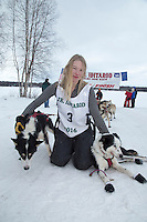 Marianna Mallory poses with her lead dogs at the finish line of the 2016 Junior Iditarod in Willow, Alaska, AK  February 28, 2016