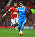 Ashley Young of Manchester United chases Anthony Reveillere of Sunderland - Manchester United vs. Sunderland - Barclay's Premier League - Old Trafford - Manchester - 28/02/2015 Pic Philip Oldham/Sportimage