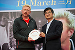 Tennis legend Boris Becker (left) receives a gift from Ke Guangming  during the press conference for the opening of Boris Becker Tennis Academy at Mission Hills Resort on 19 March 2016, in Shenzhen, China. Photo by Lucas Schifres / Power Sport Images
