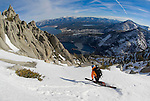 Andy Anderson drops a knee heading down the emerald bay chutes with Emerald Bay, Lake Tahoe, Cascade Lake and Fallen Leaf Lake in the background.