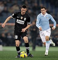 Calcio, semifinale di ritorno di Coppa Italia: Lazio vs Juventus. Roma, stadio Olimpico, 29 gennaio 2013..Juventus defender Leonardo Bonucci is chased by Lazio forward Miroslav Klose, of Germany, right, during the Italy Cup football semifinal return leg match between Lazio and Juventus at Rome's Olympic stadium, 29 January 2013..UPDATE IMAGES PRESS/Riccardo De Luca