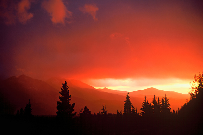 As the sun sets, the sky is turned to a bright red color, near Telluride, Colorado.