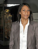 Jeannette Epps, a member of the Astronaut Class of 2009, poses for a photo near a displayed space suit at the National Air and Space Museum in Washington, D.C. on Friday, July 17, 2009.<br /> Credit: Ron Sachs / CNP