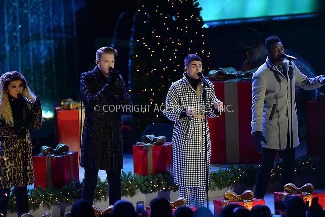 www.acepixs.com<br /> November 30, 2016  New York City<br /> <br /> Pentatonix performing at The Rockefeller Center Christmas Tree lighting ceremony on November 30, 2016 in New York City.<br /> <br /> <br /> Credit: Kristin Callahan/ACE Pictures<br /> <br /> <br /> Tel: 646 769 0430<br /> Email: info@acepixs.com