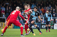 Sam Wood of Wycombe Wanderers makes a pass through Orient players during the Sky Bet League 2 match between Wycombe Wanderers and Leyton Orient at Adams Park, High Wycombe, England on 23 January 2016. Photo by Andy Rowland / PRiME Media Images.