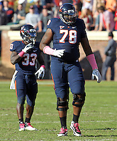 Oct. 22, 2011 - Charlottesville, Virginia - USA; Virginia Cavaliers offensive tackle Morgan Moses (78) stands in front of Virginia Cavaliers running back Perry Jones (33) during an NCAA football game against the North Carolina State Wolfpack at the Scott Stadium. NC State defeated Virginia 28-14. (Credit Image: © Andrew Shurtleff/