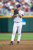 LSU Tigers pitcher Jared Poche (16) looks to his catcher for the sign against the TCU Horned Frogs in the NCAA College World Series on June 14, 2015 at TD Ameritrade Park in Omaha, Nebraska. TCU defeated LSU 10-3. (Andrew Woolley/Four Seam Images)