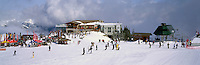 Downhill skiing and Snowboarding at the Roundhouse Lodge on Whistler Mountain, Whistler Ski Resort, BC, British Columbia, Canada - Panoramic View