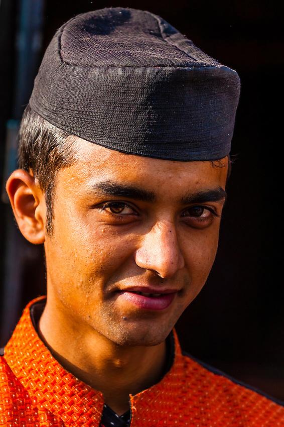 Man wearing Nepalese traditional costume, Hotel Heritage, Bhaktapur, Nepal.