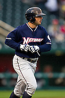 Tim Smith (24) of the Northwest Arkansas Naturals heads to first base after being walked during a game against the Springfield Cardinals on May 13, 2011 at Hammons Field in Springfield, Missouri.  Photo By David Welker/Four Seam Images.