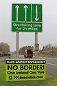 SPECIAL BREXIT FEA ON ANTRIM AND SDC TRAILERS FOR Arthur Beesley  - 9/1/2019: Traffic pass an anti Brexit sign on the main County Londonderry/Derry to County Antrim, Northern Ireland. Photo/Paul McErlane