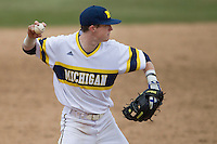 Michigan Wolverines third baseman Jacob Cronenworth (2) makes a throw to first base during the NCAA baseball game against the Washington Huskies on February 16, 2014 at Bobcat Ballpark in San Marcos, Texas. The game went eight innings, before travel curfew ended the contest in a 7-7 tie. (Andrew Woolley/Four Seam Images)