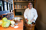 Chef/Owner Chris Israel prepping sauerkraut in his downtown Portland restaurant, Grüner.