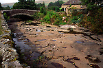 Dried river bed with potholes, River Dee, Cowgill, Dentdale, Cumbria, England