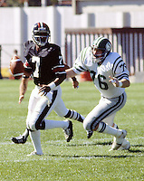 Bill Baker Saskatchewan Roughriders chases Condredge Holloway Ottawa Rough Rider quarterback. 1978 Copyright photograph Scott Grant