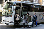 Foreign visitors enter board their tour bus with their shopping in the Ginza district on January 20, 2016, Tokyo, Japan. The Japan National Tourism Organization reported on Tuesday 19th a record increase in foreign visitors in 2015. Approximately 19.73 million people visited Japan from abroad, up 47.3 percent. According to the report there were more Chinese visitors than from any other nation with 4.99 million coming in 2015. South Korea (4 million) and Taiwan (3.67 million) were next on the list, and over 1 million Americans also visited Japan in 2015. The number of visitors is the highest in 45 years and already close to Japan's goal of attracting 20 million foreign visitors in a year by 2020. (Photo by Rodrigo Reyes Marin/AFLO)