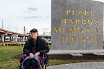 NEW HAVEN, CT. 06 December 2018-120618 - 97 year old Floyd Welch, of East Lyme,  CT's last and only remaining survivor of the attacks on Pearl Harbor, sits in front of the new park sign during the dedication ceremonies of the Pearl Harbor Memorial Park located below the Pearl Harbor Memorial Bridge in New Haven on Thursday. Bill Shettle Republican-American