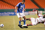 Aug 19 2007:  Davy Arnaud (22) of the Wizards is fouled by Avery John (4) of the Revolution.  The MLS Kansas City Wizards were defeated by the visiting New England Revolution 0-1 at Arrowhead Stadium in Kansas City, Missouri, in a regular season league soccer match.