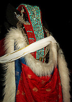 Married Ladakhi women wear the magnificent Perak that weighs between 3kg and 8 kg on their heads with the coral and Turquoise that adorns it.