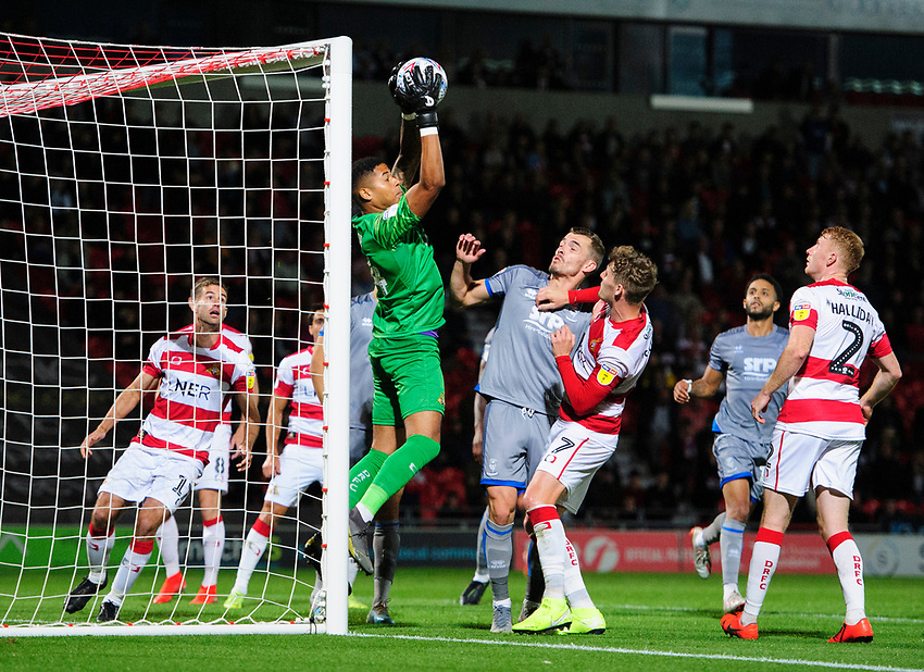 Doncaster Rovers' Seny Dieng claims a high ball under pressure from Lincoln City's Harry Toffolo<br /> <br /> Photographer Chris Vaughan/CameraSport<br /> <br /> EFL Leasing.com Trophy - Northern Section - Group H - Doncaster Rovers v Lincoln City - Tuesday 3rd September 2019 - Keepmoat Stadium - Doncaster<br />  <br /> World Copyright © 2018 CameraSport. All rights reserved. 43 Linden Ave. Countesthorpe. Leicester. England. LE8 5PG - Tel: +44 (0) 116 277 4147 - admin@camerasport.com - www.camerasport.com