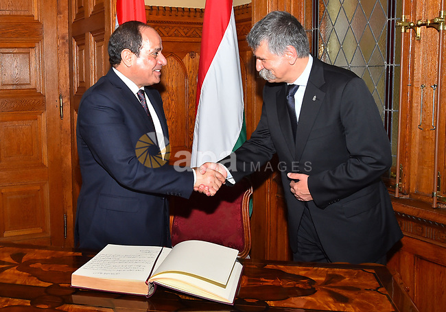 Egyptian President Abdel Fattah al-Sisi meets shakes hands with Speaker of the Hungarian Parliament Laszlo Kover in the Parliament building in Budapest, Hungary on July 3, 2017. Photo by Egyptian President Office