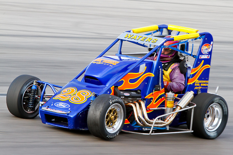May 28, 2011: Jim Waters (28) lifts his front-left wheel as he flies through turn three at The Bullring at Las Vegas Motor Speedway.