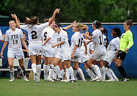 Florida International University women's soccer players celebrate their goal against the University of Denver on October 16, 2011 at Miami, Florida. FIU won the game 1-0. .