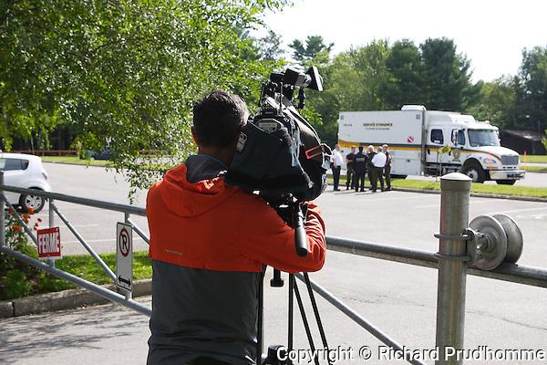 A cameraman films the SQ divers at Dorwin falls park in Rawdon, Quebec