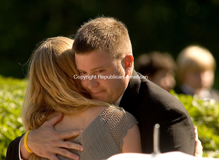 WASHINGTON, CT - 10 JULY 2005 -071005JS05--Michael Condon, a childhood friend of Maj. Stephen Reich, gives a hug to Reich's wife Jill Blue Reich,  during a service of prayer and thanksgiving Sunday at Washington Town Hall. Reich and 15 other service members were killed on June 28 when their MH47 Chinook helecopter was shot down in Afghanistan --Jim Shannon Photo-- Jill Blue Reich, Michael Condon; Maj. Stephen Reich; Afghanistan are CQ