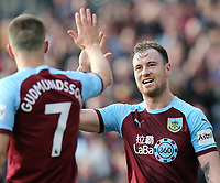 Burnley's Ashley Barnes (right) and Johann Gudmundsson celebrate at the final whistle<br /> <br /> Photographer Rich Linley/CameraSport<br /> <br /> The Premier League - Burnley v Wolverhampton Wanderers - Saturday 30th March 2019 - Turf Moor - Burnley<br /> <br /> World Copyright © 2019 CameraSport. All rights reserved. 43 Linden Ave. Countesthorpe. Leicester. England. LE8 5PG - Tel: +44 (0) 116 277 4147 - admin@camerasport.com - www.camerasport.com
