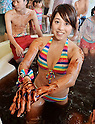 Chocolate bath, February 14, 2015 , Hakone, Kanagawa, Japan : A female bather rubs herself in chocolate sauce at Hakone Yunessun spa resort facilities in Hakone, Kanagawa prefecture Japan, on February 14, 2015. The resort is famous for its multiple themed baths and also hosts coffee, green tea, sake and wine baths.