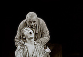 "King Lear (Anthony Hopkins) and Edgar (Bill Nighy) in  ""King Lear"" by William Shakespeare at the National Theatre, London 1986.  Directed by David Hare and designed by Hayden Griffin."