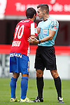 Sporting de Gijon's Nacho Cases have words with the referee Carlos del Cerro Grande during La Liga match. September 24,2016. (ALTERPHOTOS/Acero)