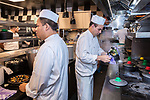 """BRUSSELS - BELGIUM - 16 December 2019 --  Restaurant """"Chez Léon"""" with a concept of serving """"Mussels and Fries"""", was established in 1893 in Brussels. It is the largest restaurant in the country in terms of turnover, number of customers and staff.Kevin Peters (L) and Dadouch Farid are responsible for the different mussels dishes in the kitchen. -- PHOTO: Juha ROININEN / EUP-IMAGES"""