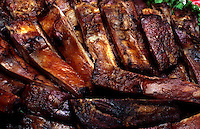 Close up of barbequed ribs with beef BBQ sauce.