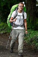 Pilgrims walk to Santiago de Compostela, by village Ferreiros in Sarria