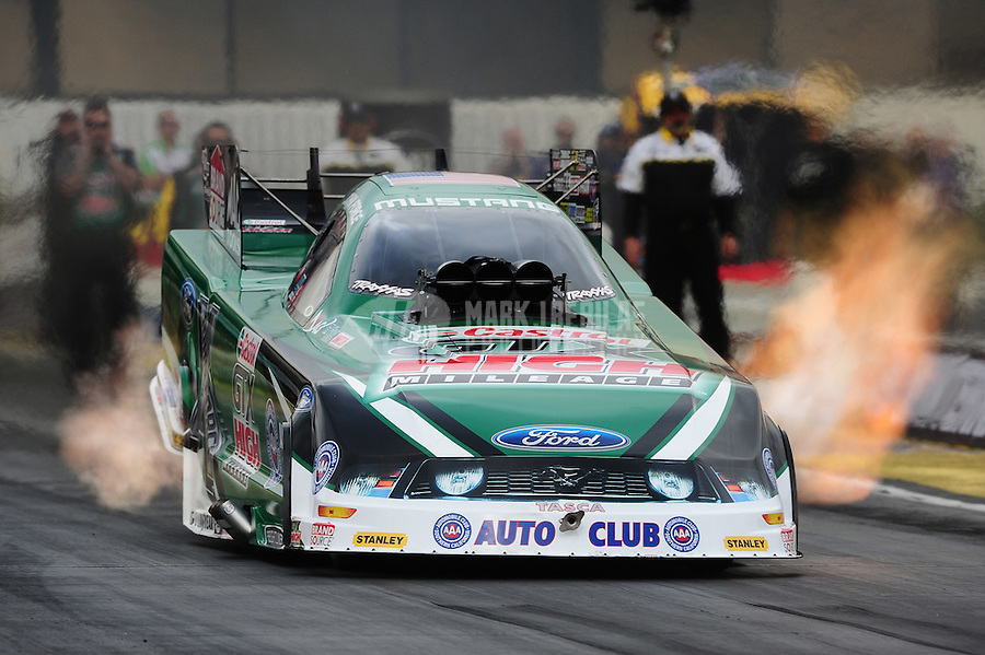 Feb. 12, 2012; Pomona, CA, USA; NHRA funny car driver John Force during the Winternationals at Auto Club Raceway at Pomona. Mandatory Credit: Mark J. Rebilas-