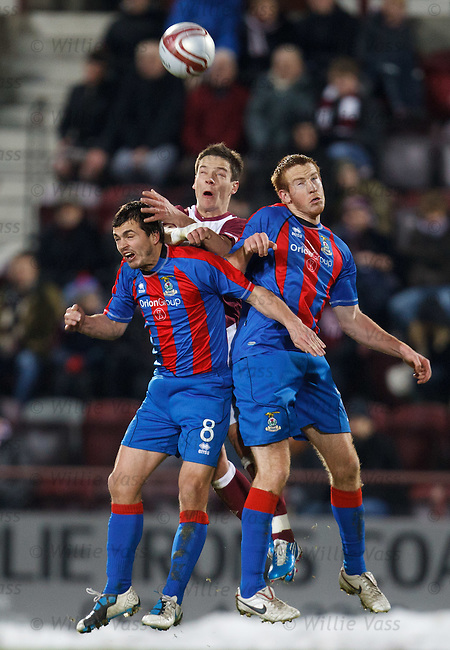 Ian Black sandwiched by Inverness players Russell Duncan and Adam Rooney