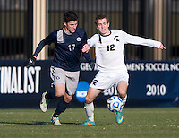 Tom Skelly (17) of Georgetown fights for the ball with Andrew Herr (12) of Michigan State during the third round of the NCAA tournament at Shaw Field in Washington, DC. Michigan State defeated Georgetown, 1-0.