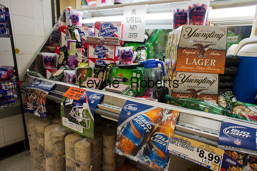 A supermarket in New York displays a selection of snacks and beer (mostly beer) on Tuesday, January 24, 2012 in anticipation of the upcoming February 5th Superbowl game between the New England Patriots and the local New York Giants. A recent study revealed that 59% of people would prefer to watch the game on television. The study is by a company that provides deals on electronic products. (© Richard B. Levine)