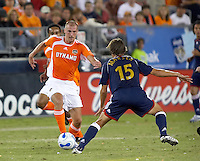 Houston Dynamo forward Paul Dalglish (8) attempts to dribble past Chivas USA midfielder Jesse Marsch (15).  Houston Dynamo beat CD Chivas USA 2-0 at Robertson Stadium in Houston, TX on October 29, 2006 to gain a berth in the Western Conference Final on a 3-2 aggregate.