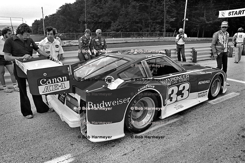Co-drivers Sam Posey and Paul Newman wait to drive the Datsun 280ZX Turbo during practice for the Camel GT IMSA race at Road America near Elkhart Lake, Wisconsin, on August 31, 1980. (Photo by Bob Harmeyer)