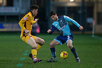 Joe Jacobson of Wycombe Wanderers takes on Tom Owen-Evans of Newport County during the Sky Bet League 2 match between Newport County and Wycombe Wanderers at Rodney Parade, Newport, Wales on 22 November 2016. Photo by Mark  Hawkins.
