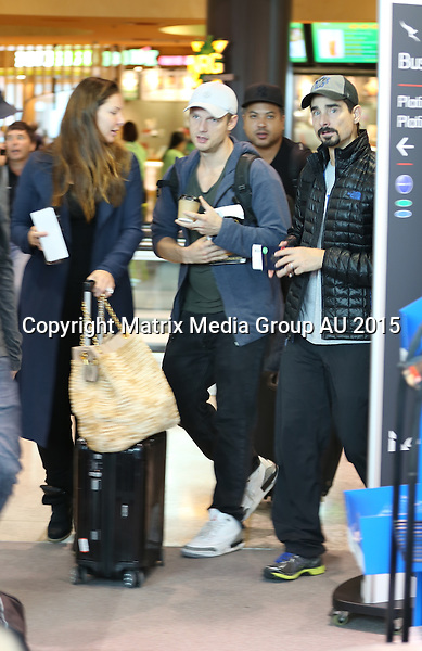 10 MAY 2015 SYDNEY AUSTRALIA<br /> <br /> EXCLUSIVE PICTURES<br /> <br /> Backstreet Boys Kevin Richardson and Nick Carter pictured with his wife Lauren Kitt jetting out of Sydney.