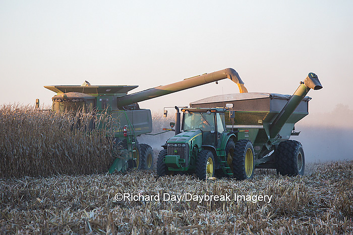 63801-06612 John Deere combine harvesting corn while unloading corn into wagon, Marion Co., IL