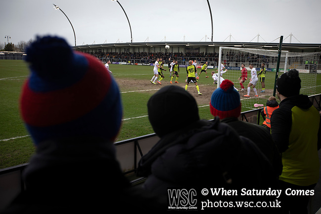 AFC Fylde 1, Aldershot Town 0, 14/03/2020. Mill Farm, National League. Visiting supporters look on during the first-half as AFC Fylde (in white) defend their goal against Aldershot Town in a National League game at Mill Farm, Wesham. The fixture was played against the backdrop of the total postponement of all Premier League and EFL football matches due to the the coronavirus outbreak. The home team won the match 1-0 with first-half goal by Danny Philliskirk watched by a crowd of 1668. Photo by Colin McPherson.