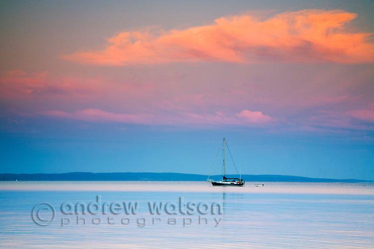 A yacht on Geographe Bay at dawn, Western Australia, AUSTRALIA.
